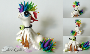 Iris - the rainbow griffin - clay sculpture by CalicoGriffin