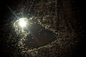 Heart-shaped Puddle of Mud by rachelarandilla