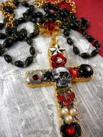Collaged skull cross necklace by janedean