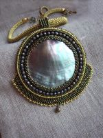Green pearl shell bead embroidered pendant by nikkichou