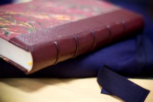 My first half leather book on my bookbinder apron by K-a-k-i