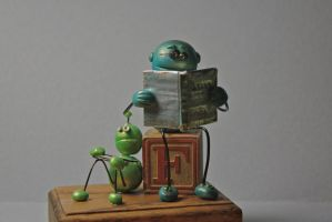 Robot reading to little robot 2 by sillysarasue