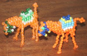 Beaded costumed camels by Anabiyeni