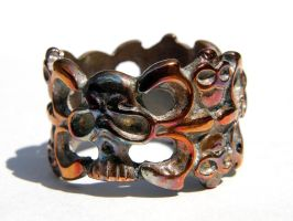 Heat Patina on Skull Ring by redtailhawker