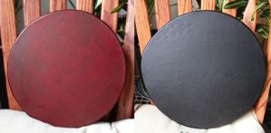 Red and black dyed deer rawhide drums by lupagreenwolf