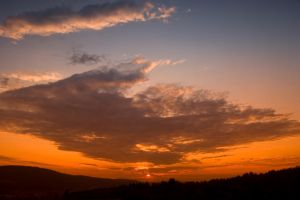 Sunset with Giant Cloud by happeningstock