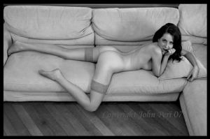 Young lady on couch by JohnPeri