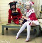 Neko sisters celebrating Christmas~! by RoxiiCosplay