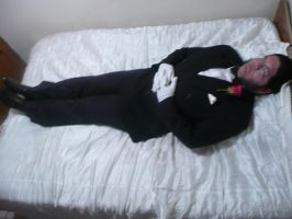 Lying in bed wearing a tuxedo by Hellboy777Kratos