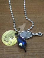 Lapis Lazuli stamped pendant by theevergreenburrow
