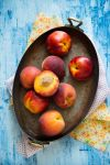 Peaches and nectarines in vintage pot by BeKaphoto