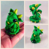 Sweet little green Dragoness  by HereThereBeSculpture
