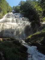 Beams of light shining in to the falls by Mathayis