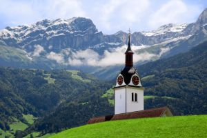 Steeple in the Swiss Alps by ZingZama