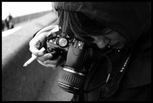 http://th01.deviantart.com/fs7/300W/i/2005/264/a/d/camera_and_cigarette_00_by_nothingeater.jpg