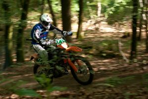 Motorcyclist in blured Wood by CunisiaInc