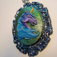 Really surprised unicorn pendant by slinkskull