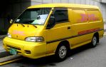 The Iconic Yellow DHL Delivery Van by toyonda
