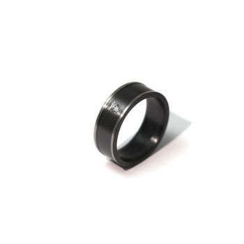 Black and white zirconium ring with a sapphire by timjo