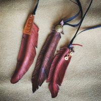 HANDMADE leather feather pendants by nondecaf