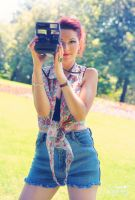 Girl with camera by AnnOmar