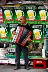 The Accordion Player by Goksy