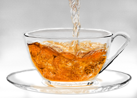 Pouring tea into glass cup by MacAodhagain