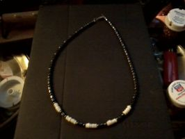 Hematite and Puka Necklace by DenaliVonChrystshun
