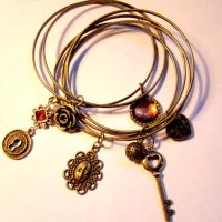 Steampunk Charm Bracelet Cuffs by SteamSociety