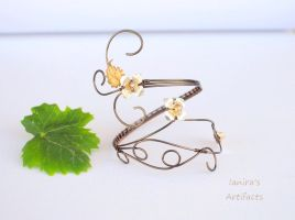 Vintage wire wrapped arm cuff by IanirasArtifacts