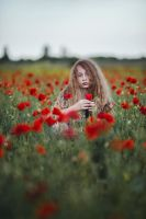 Girl and poppies by thefirebomb