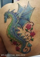 Dragon with flowers tattoo by IAteAllMyPaste