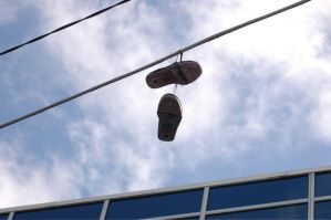 Dangling Shoe by mercurydrinker