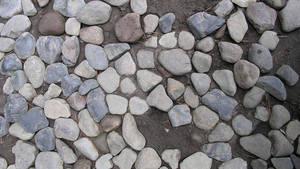Stones roughly cobbled in mud by mesilliac