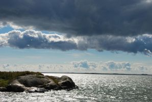 Clouds and sun over Suomenlinna by hoshitsu