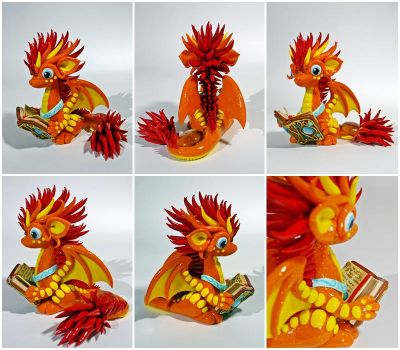 A fire dragon reading the book of water magic by CuteDragonsAndMore