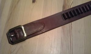 Cartridgebelt detail by Kristiantyrann