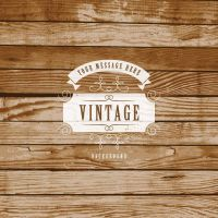 Vintage Label On Wooden Background Vector Graphic by freebiespsd
