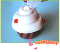 White swirly cupcake by coffishop