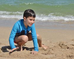 Boy playing in sand by blackroseangel89