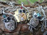 Steampunk owl necklaces by Hiddendemon-666