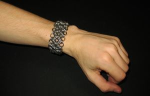 chainmail bracelet on arm by DracoLoricatus