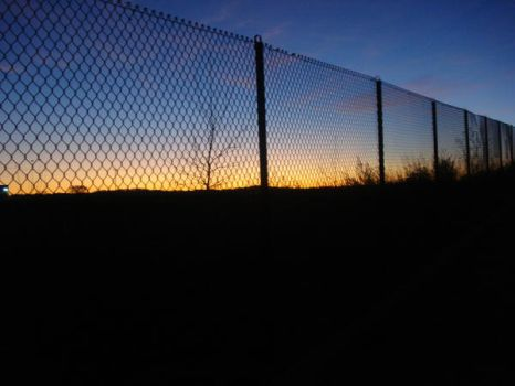Fence and Sunset by Darkneah