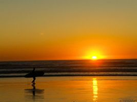 Surfer and Sunset by OneofakindKnight