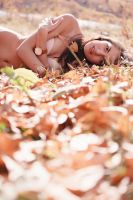 Woman in the yellow leaves by tosherr