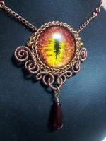 Fire eye in Copper and Brass Coiled Wire with Red  by BacktoEarthCreations