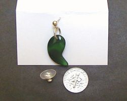 green magatama earring by wombat1138