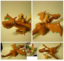 Charizard and Charmander by Foureyedalien
