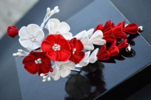 Modern Maiko: red and white ume kanzashi. by hanatsukuri