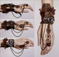 Another spiked gears cuff by Pinkabsinthe